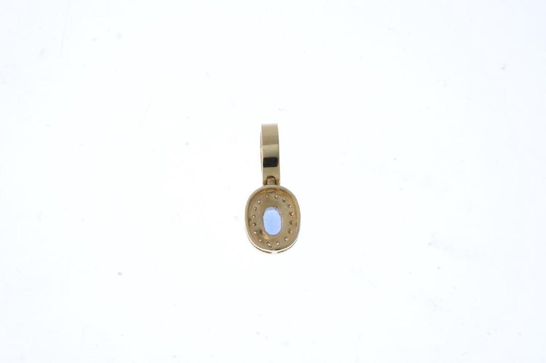 A tanzanite and diamond pendant. The oval-shape - 2