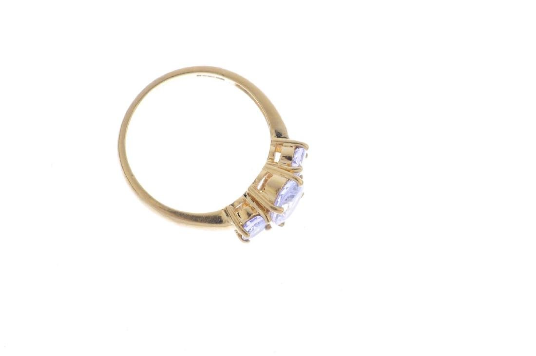 An 18ct gold tanzanite three-stone ring. The oval-shape - 2