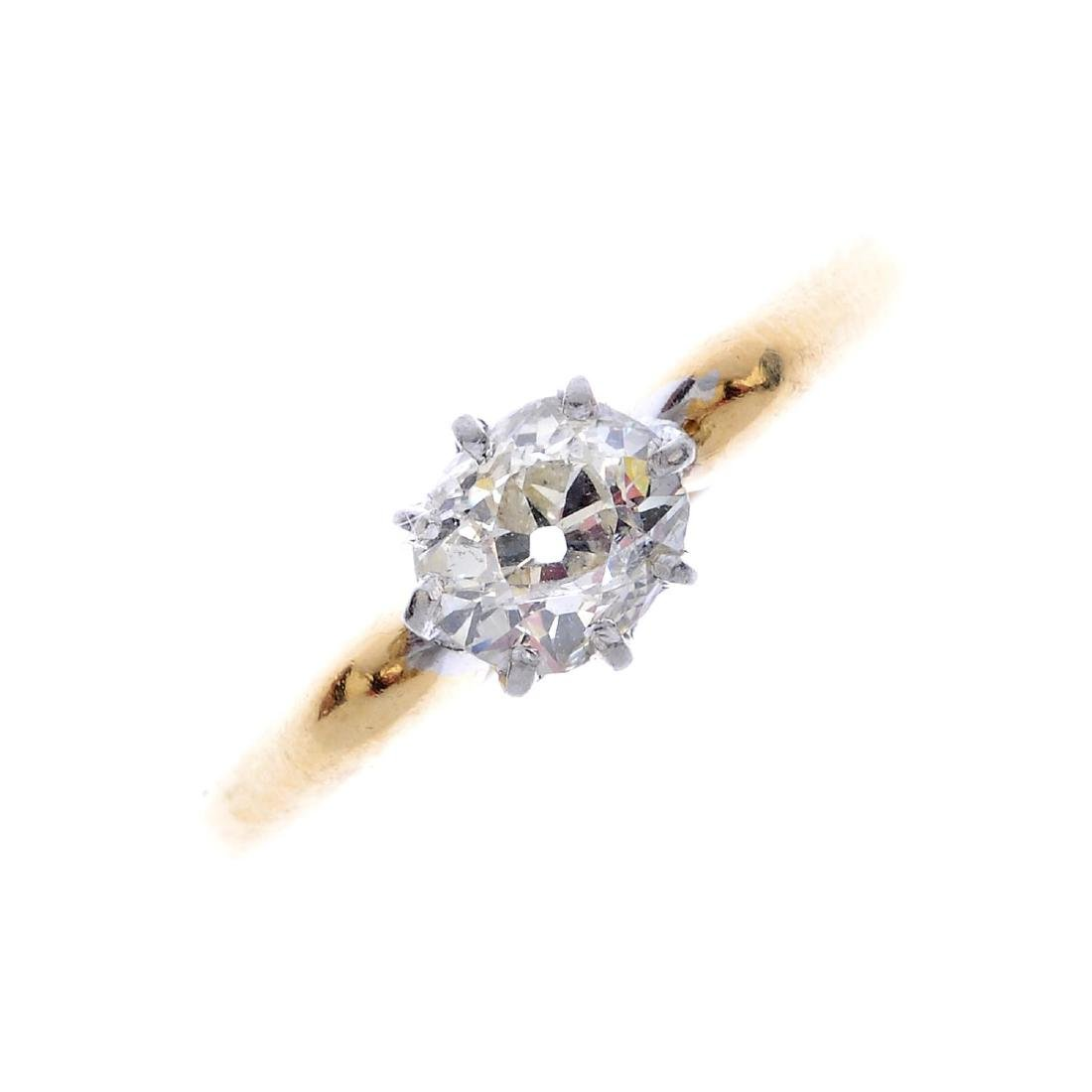 A diamond single-stone ring. The old-cut diamond, with