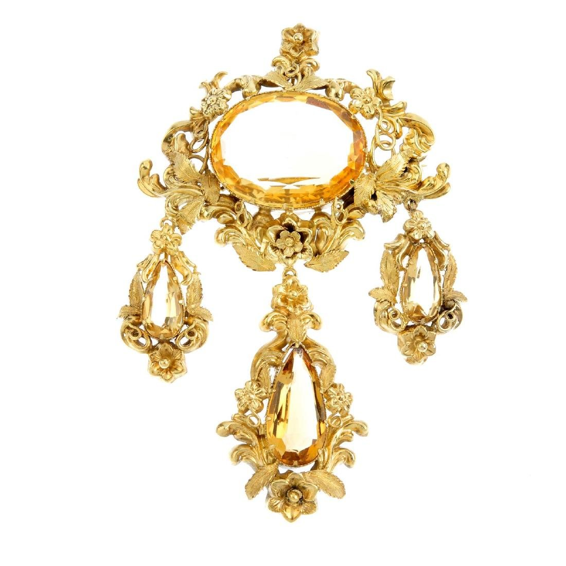 An early Victorian gold and citrine pendant. Designed