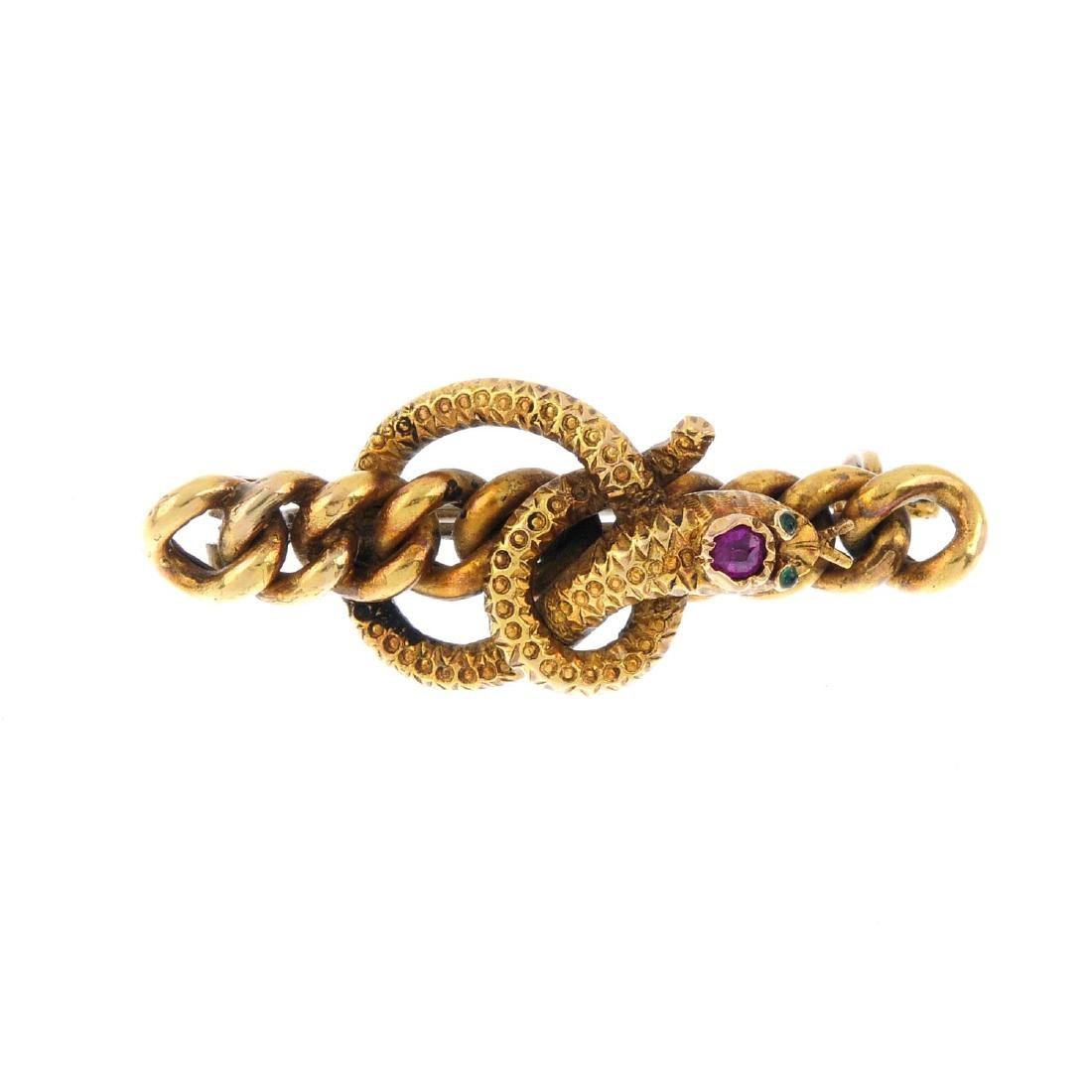 A late Victorian gem-set snake brooch. Designed as a