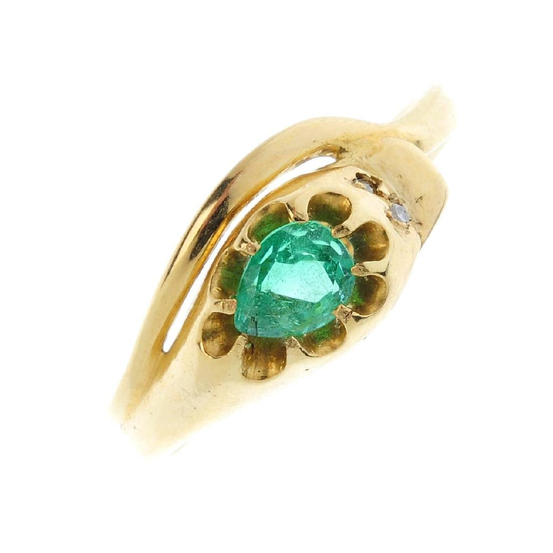 An emerald snake ring. Designed as a coiled snake, with