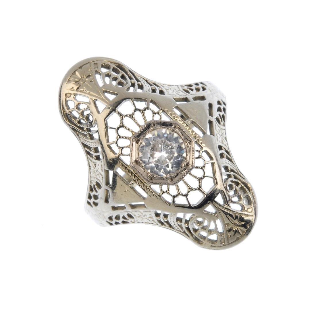 A zircon dress ring. The circular-shape zircon, within