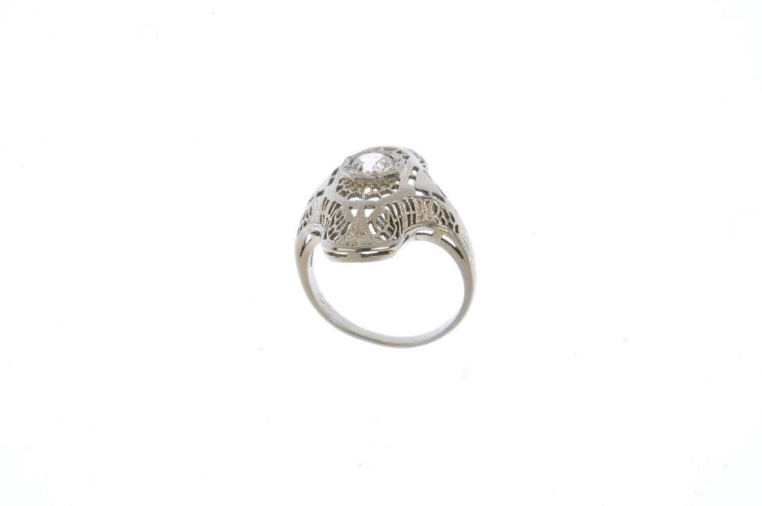 A zircon dress ring. The circular-shape zircon, within - 2