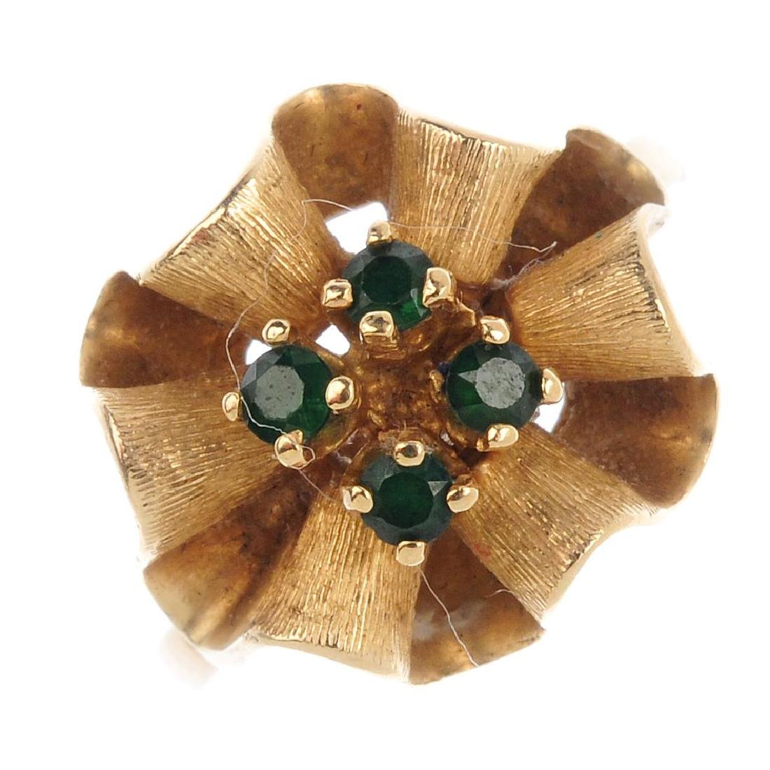 A soudé emerald dress ring. The four circular-shape