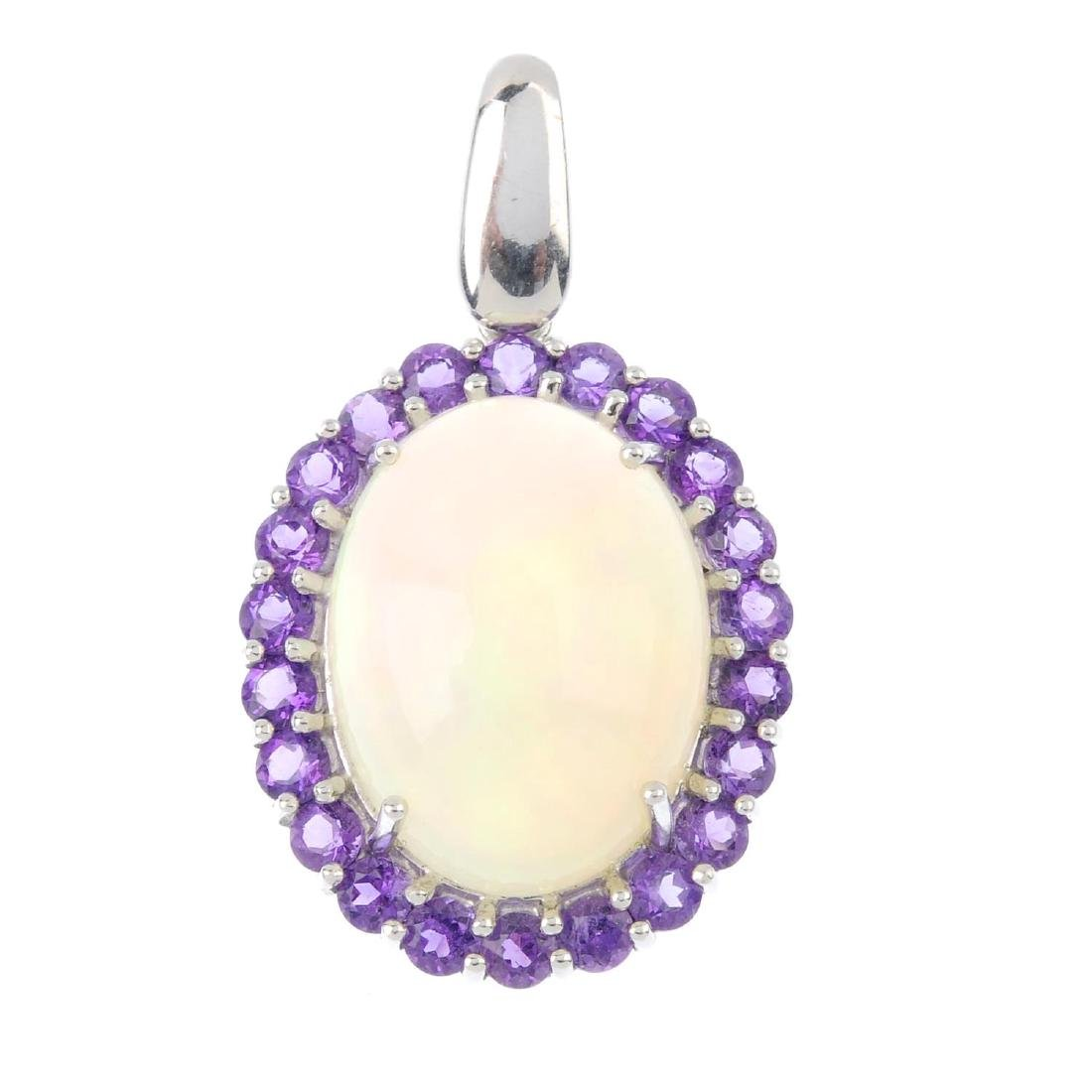 An opal and amethyst pendant. The oval opal cabochon,