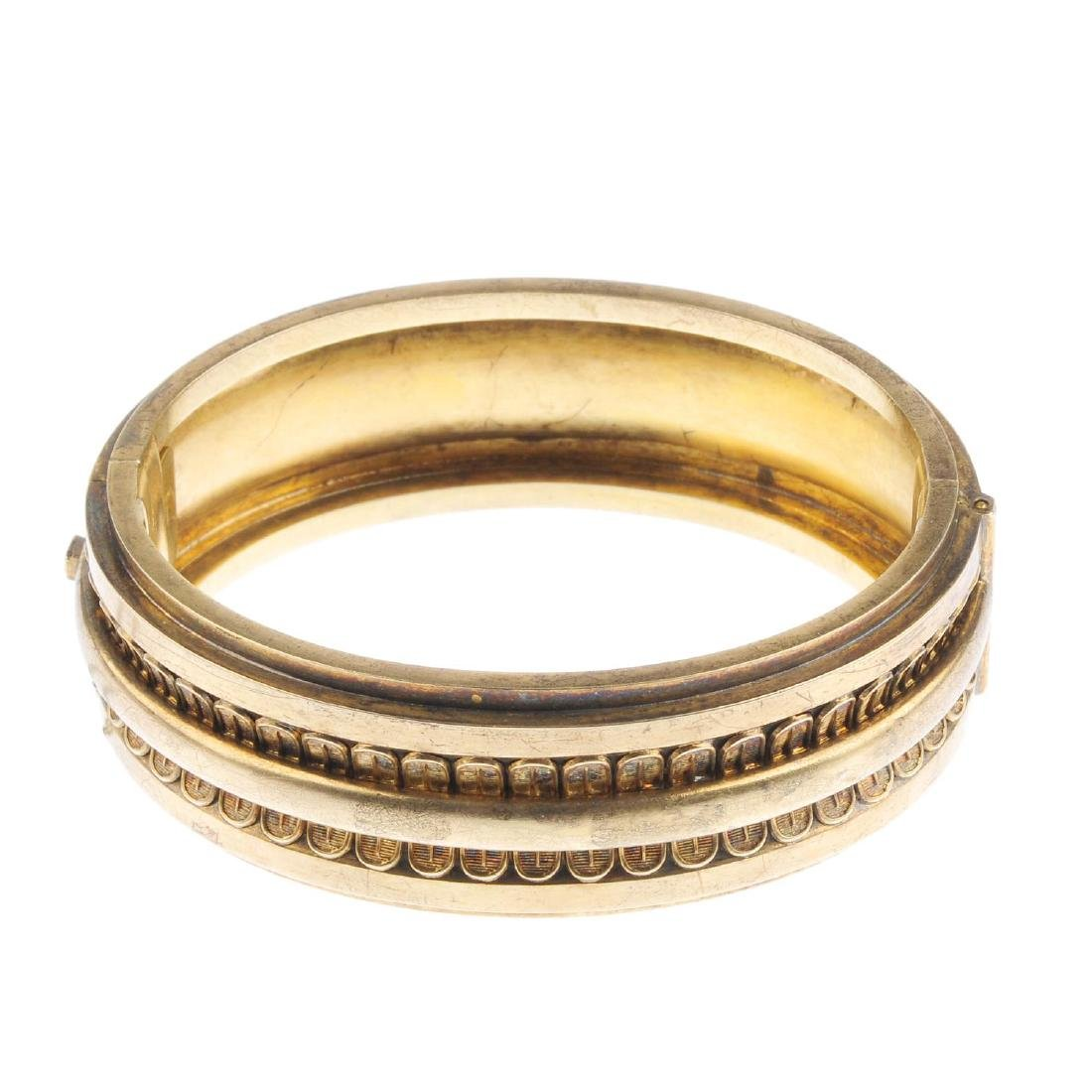 A late Victorian gold hinged bangle. The polished