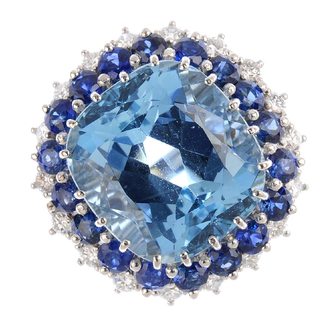 An aquamarine, sapphire and diamond cluster ring. The