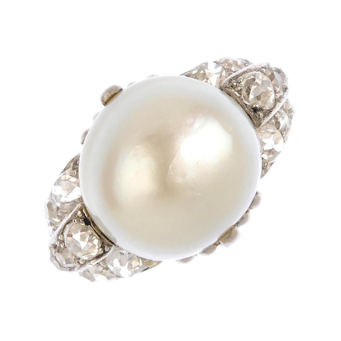 A cultured pearl and diamond dress ring. The cultured