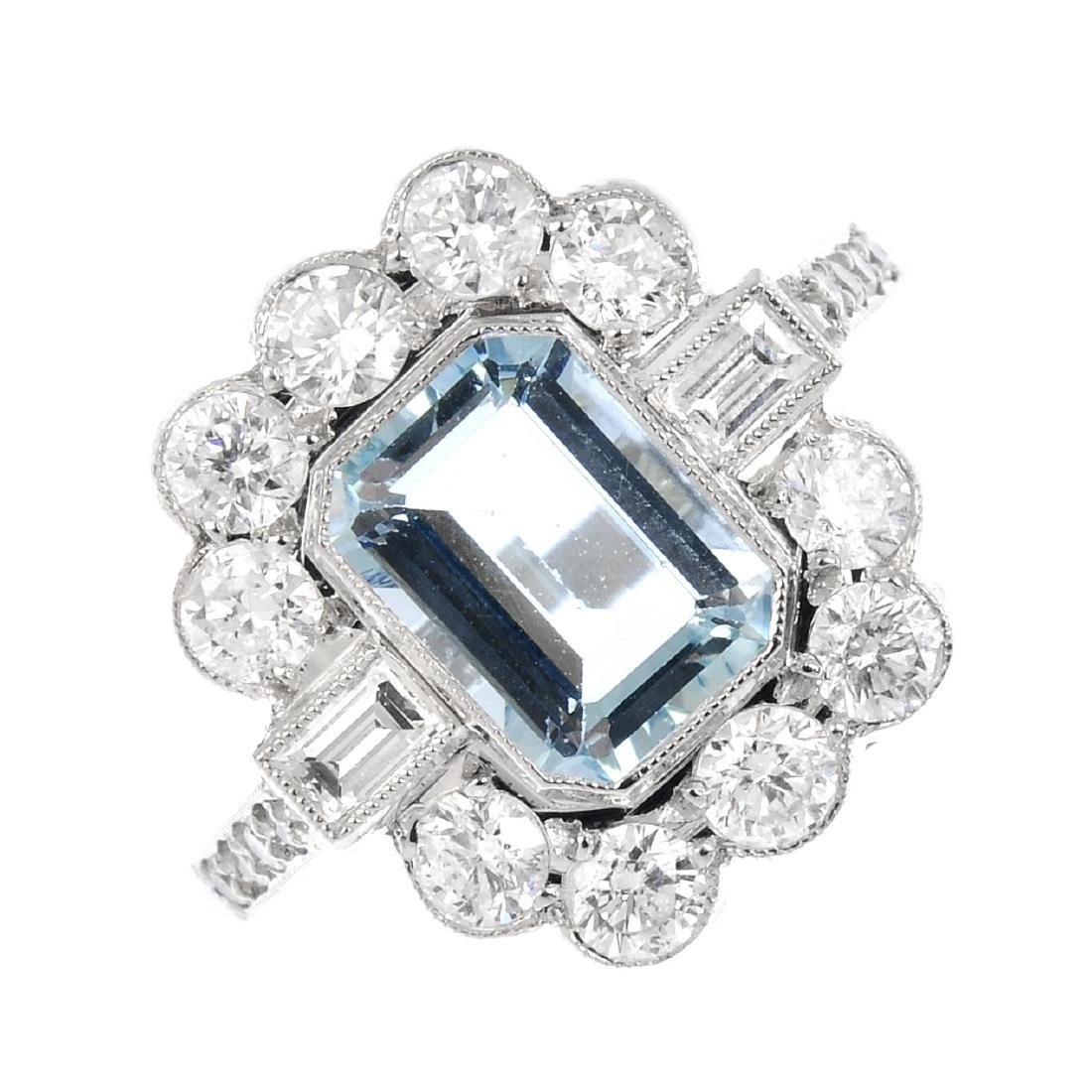 An aquamarine and diamond cluster ring. The