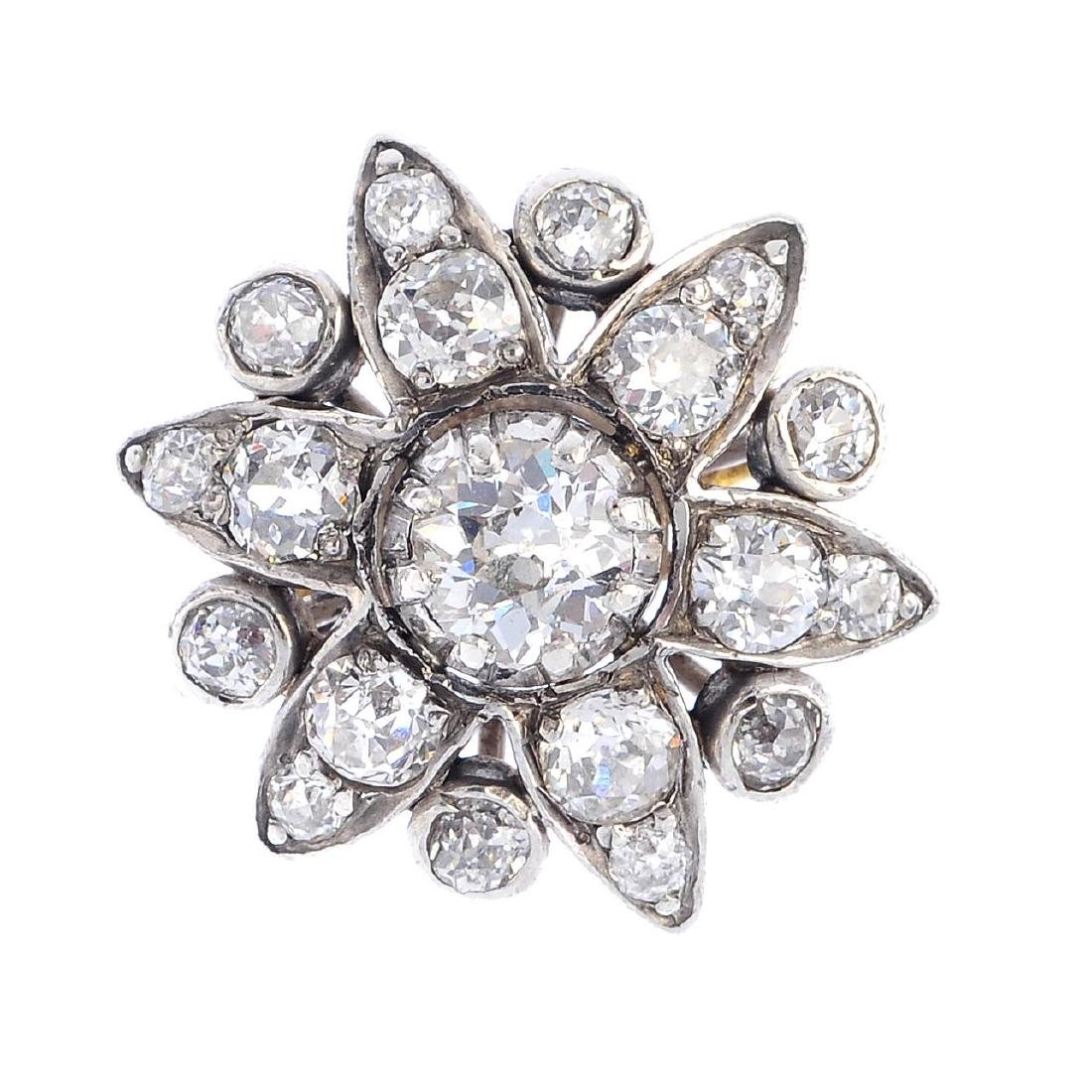 An 18ct gold diamond floral cluster ring. The old-cut