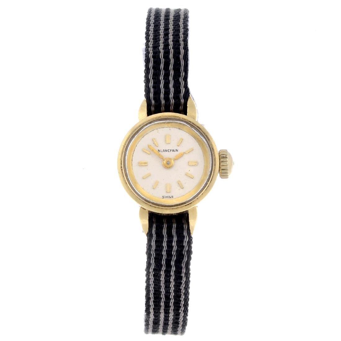 BLANCPAIN - a lady's wrist watch. Yellow metal case.