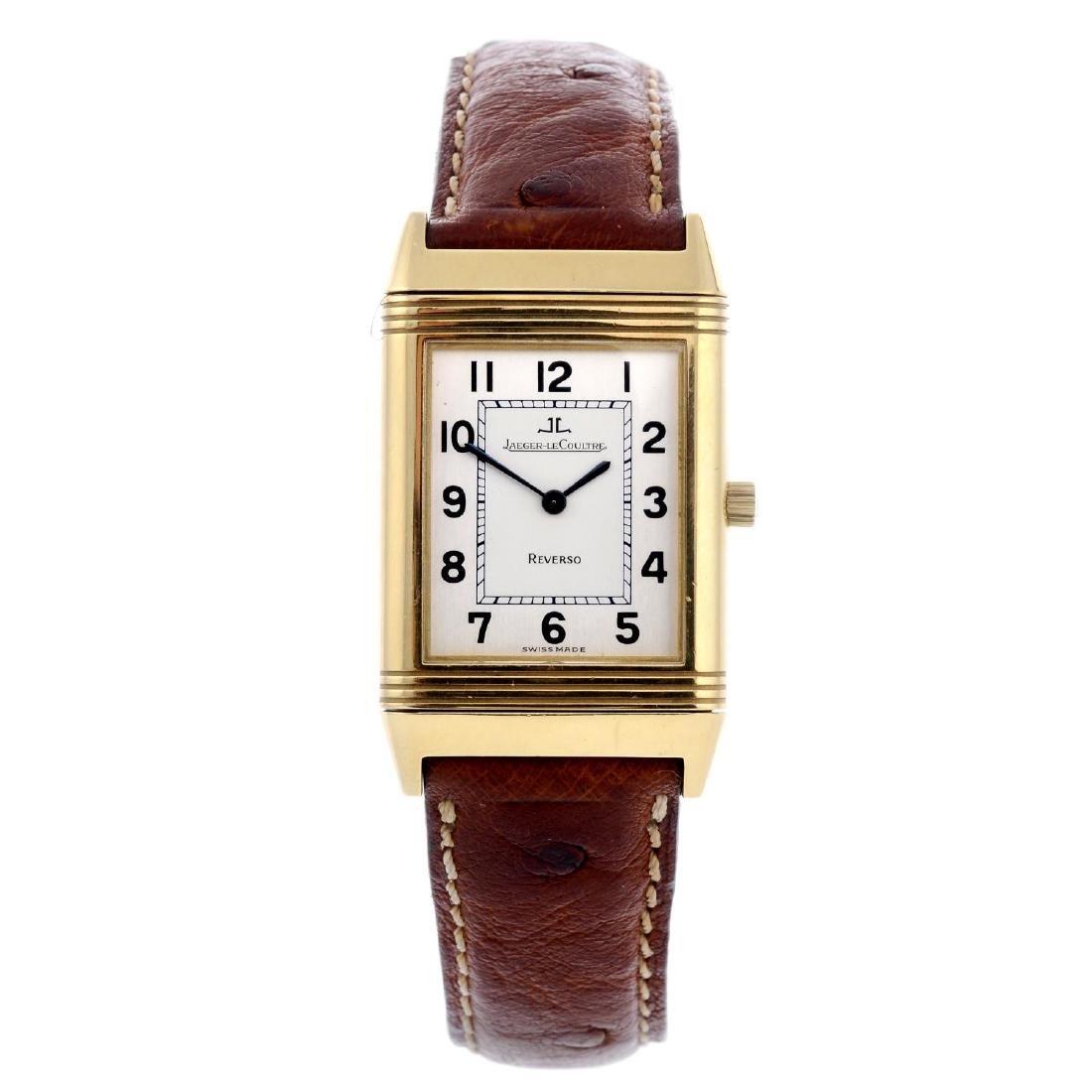 JAEGER-LECOULTRE - a Reverso wrist watch. Yellow metal