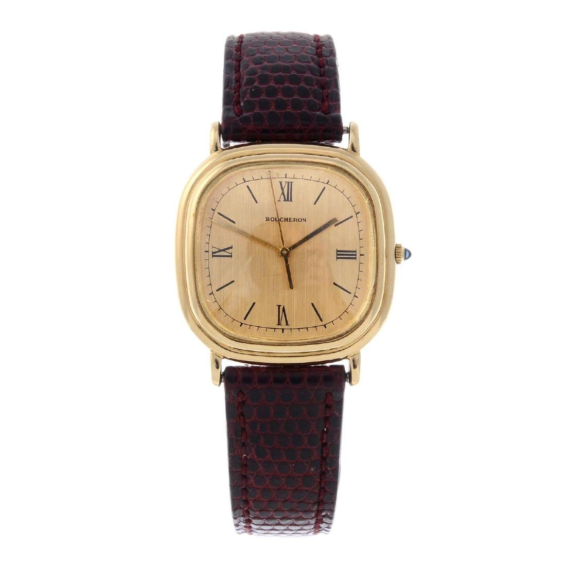 BOUCHERON - a gentleman's wrist watch. Yellow metal