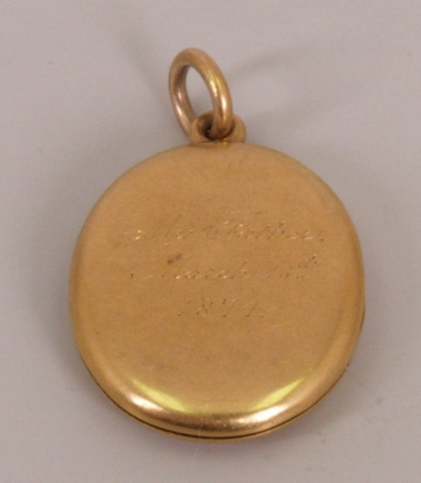 3:  Victorian oval locket of plain form with engraving