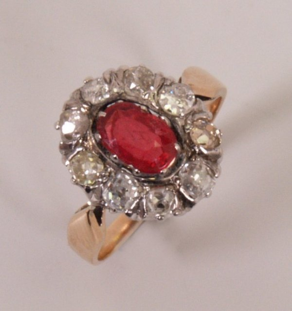 5:  Ruby and diamond cluster ring with a central oval r