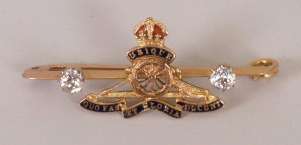 6: 9ct gold Royal Artillery bar brooch with plain wheel