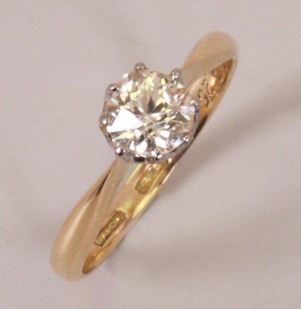 7: 18ct gold single stone diamond ring set a round bril
