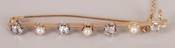 8:  Diamond and split pearl bar brooch with four old Eu