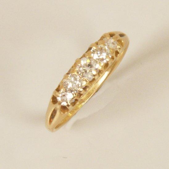 10: 18ct gold five stone old European cut diamond set r