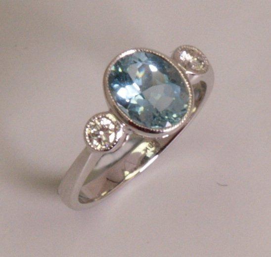 24: 18k white gold three stone aquamarine and diamond r