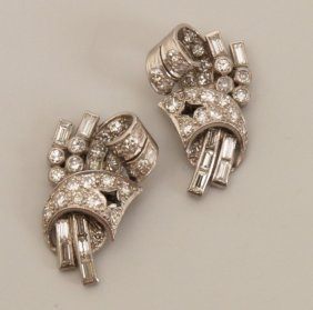 Pair Of Art Deco Style Diamond Stud Earrings In An