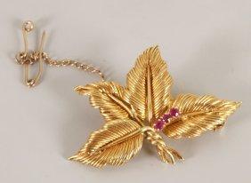 18ct Gold Three Stone Synthetic Ruby Set Leaf Desig