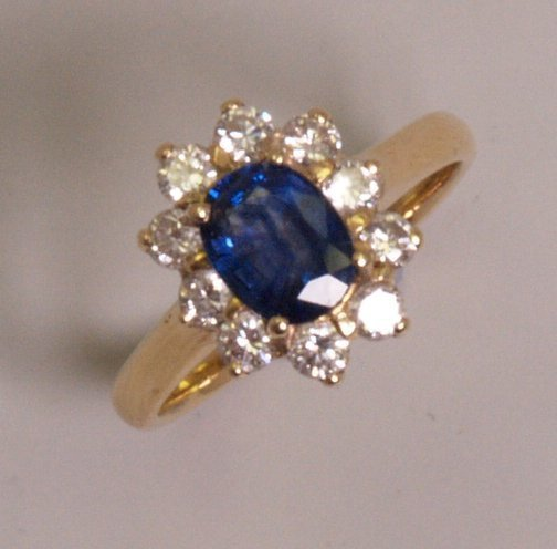 101: 18ct gold sapphire and diamond cluster ring, with