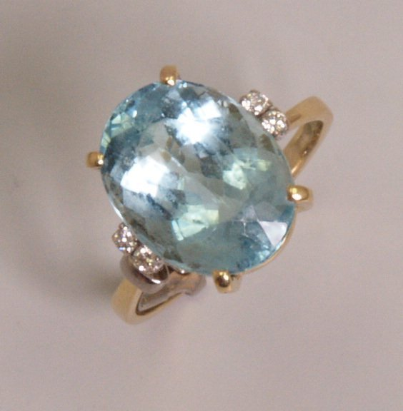 103: 18ct gold aquamarine and diamond set ring, with a
