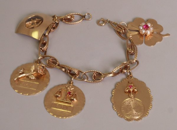 104:  A 14k gold continental fancy link bracelet, with