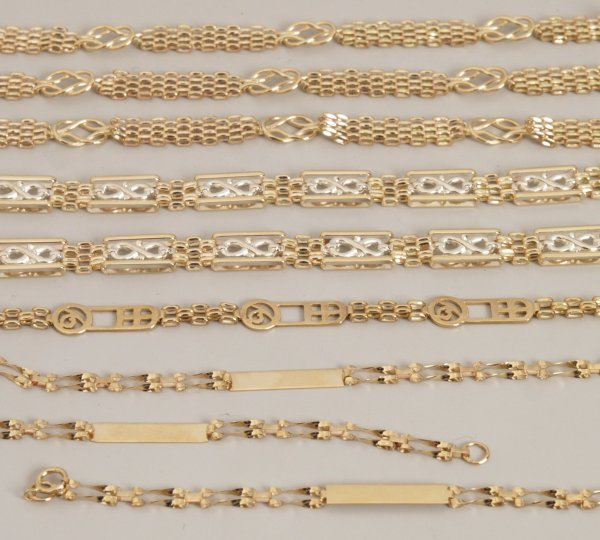115:  Nine 9ct gold bracelets to include a brick link b