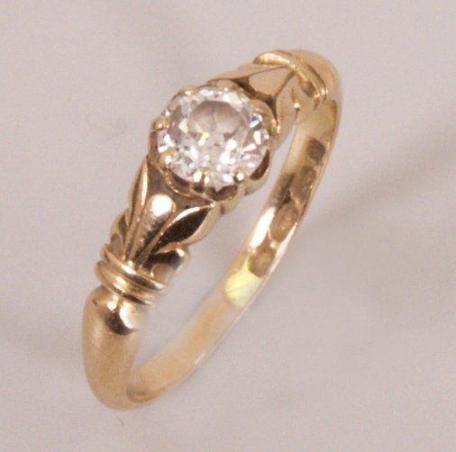 653: 18ct gold single stone old European cut diamond se