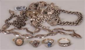924: Three silver and white metal bracelets with charm