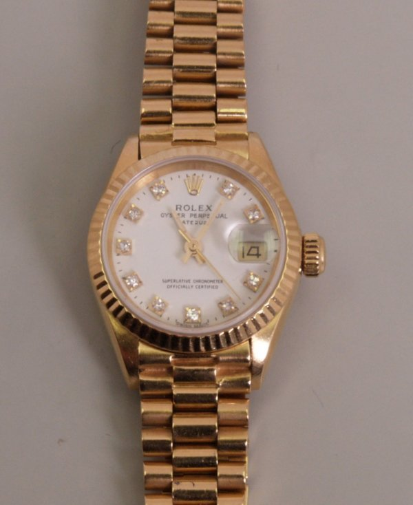 2095:  ROLEX - a ladies 18ct gold Oyster Perpetual Date