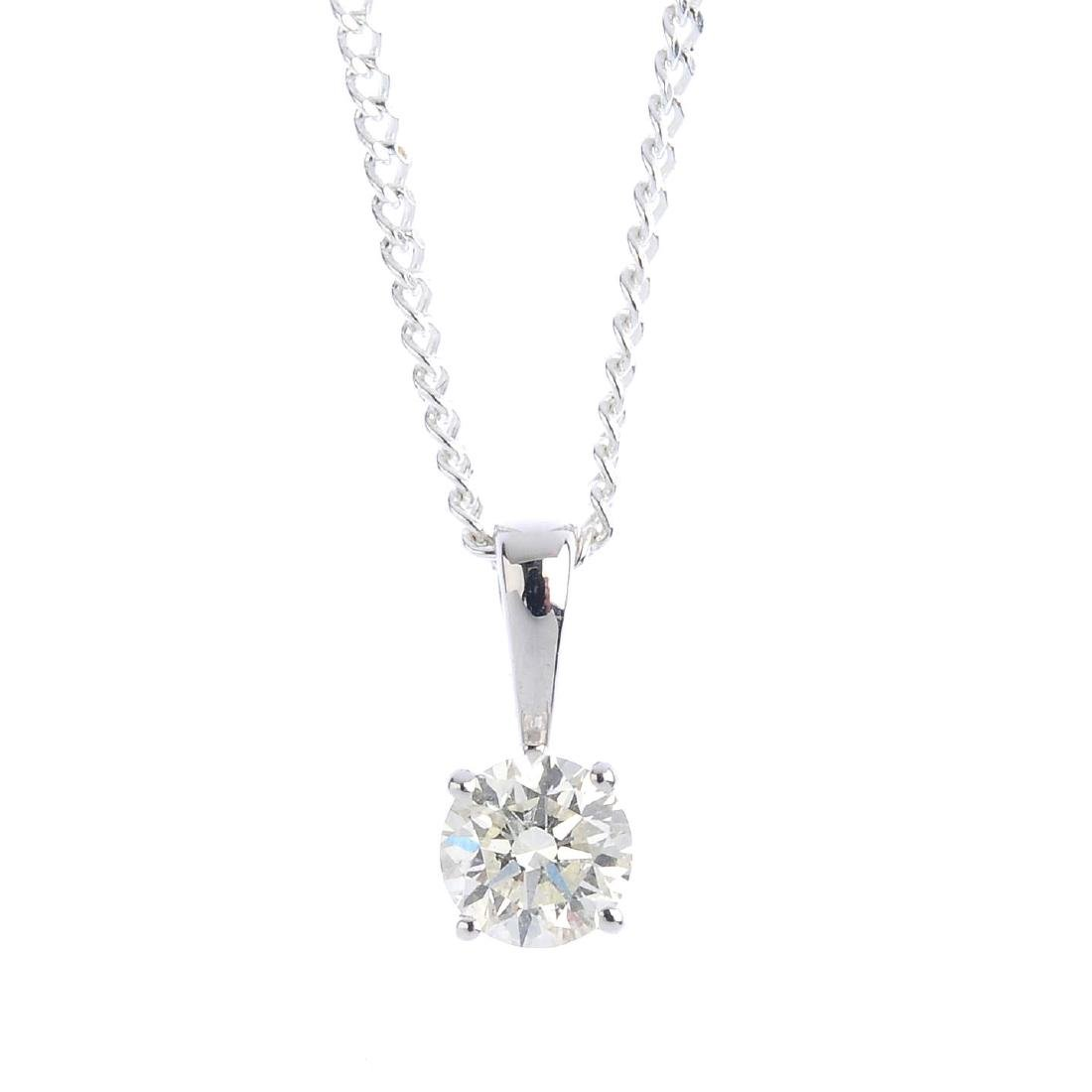 An 18ct gold diamond single-stone pendant. The
