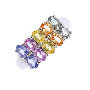 A 9ct gold sapphire dress ring Designed as a series of
