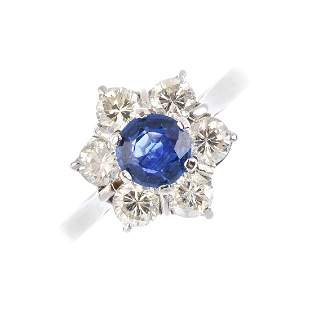 An 18ct gold sapphire and diamond cluster ring The