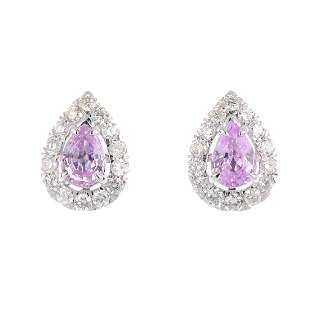 A pair of sapphire and diamond cluster earrings Each