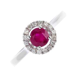 An 18ct gold ruby and diamond cluster ring The