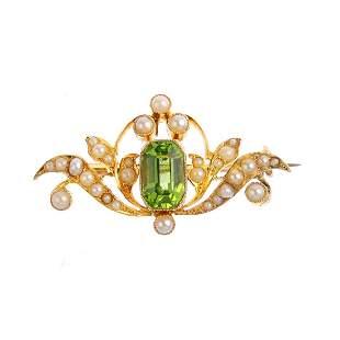 A peridot and split pearl brooch Of foliate design