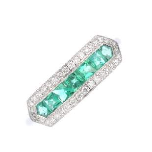 An 18ct gold emerald and diamond dress ring The