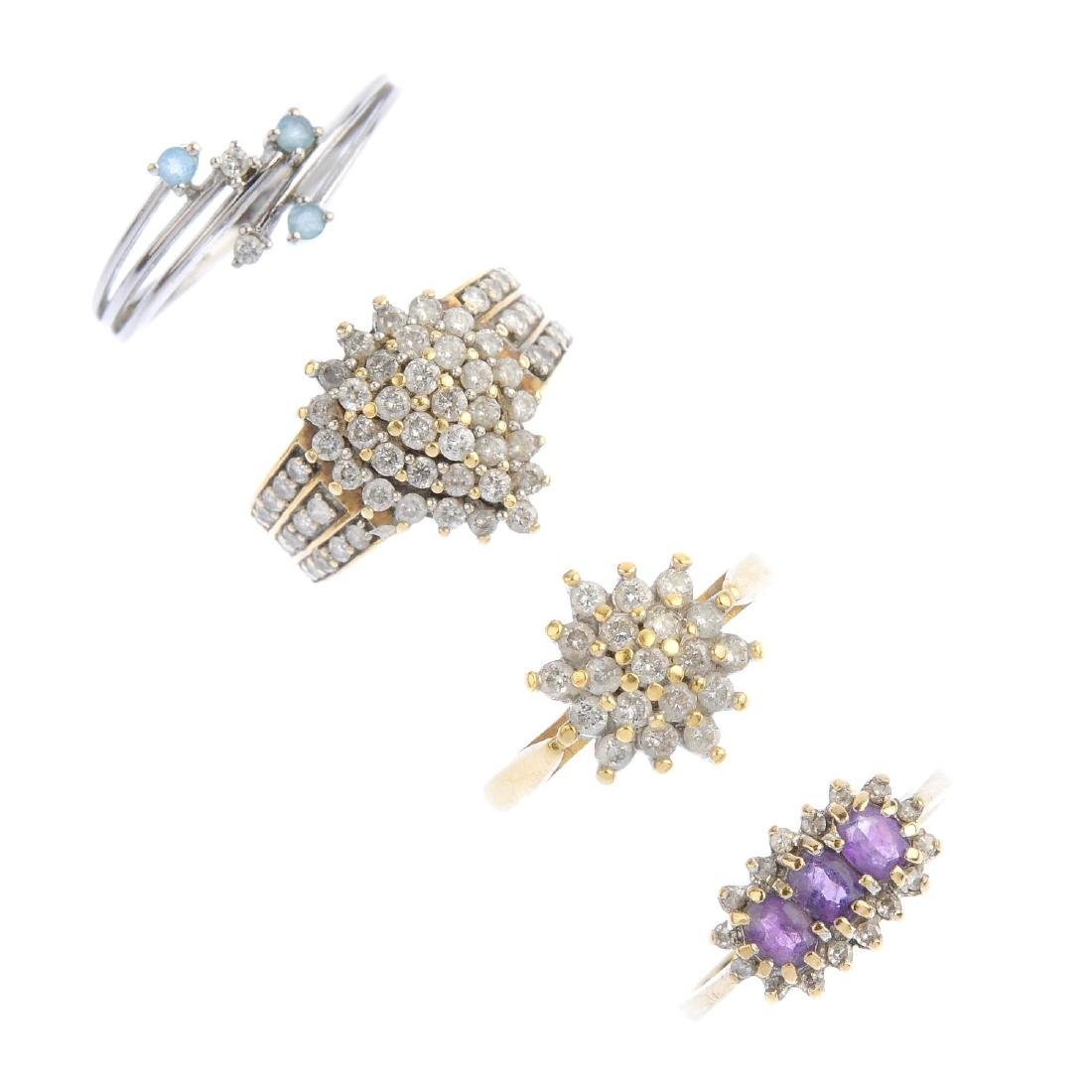 Four diamond and gem-set dress rings. To include a 9ct