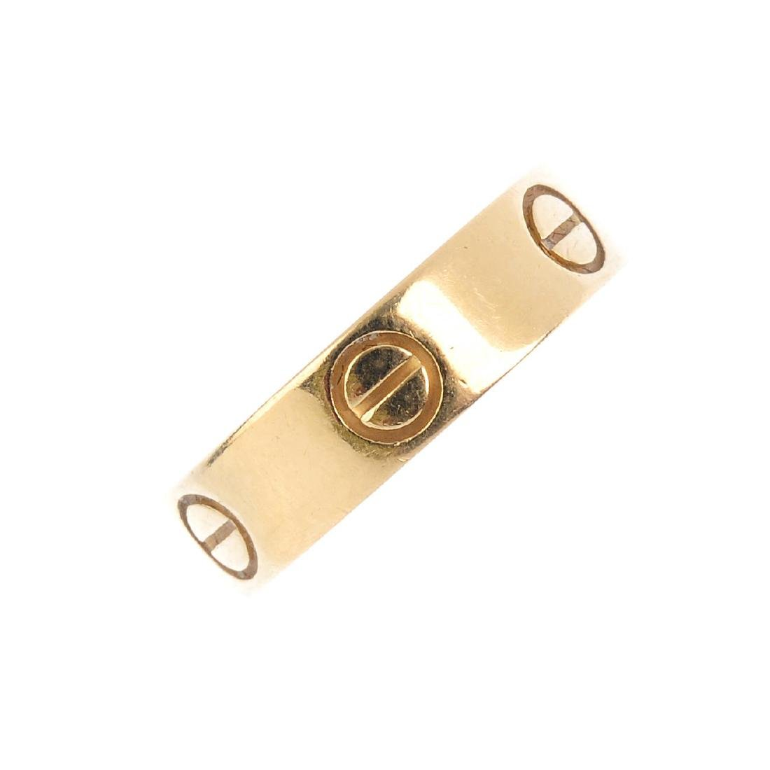CARTIER - an 18ct gold 'Love' ring. The polished band,