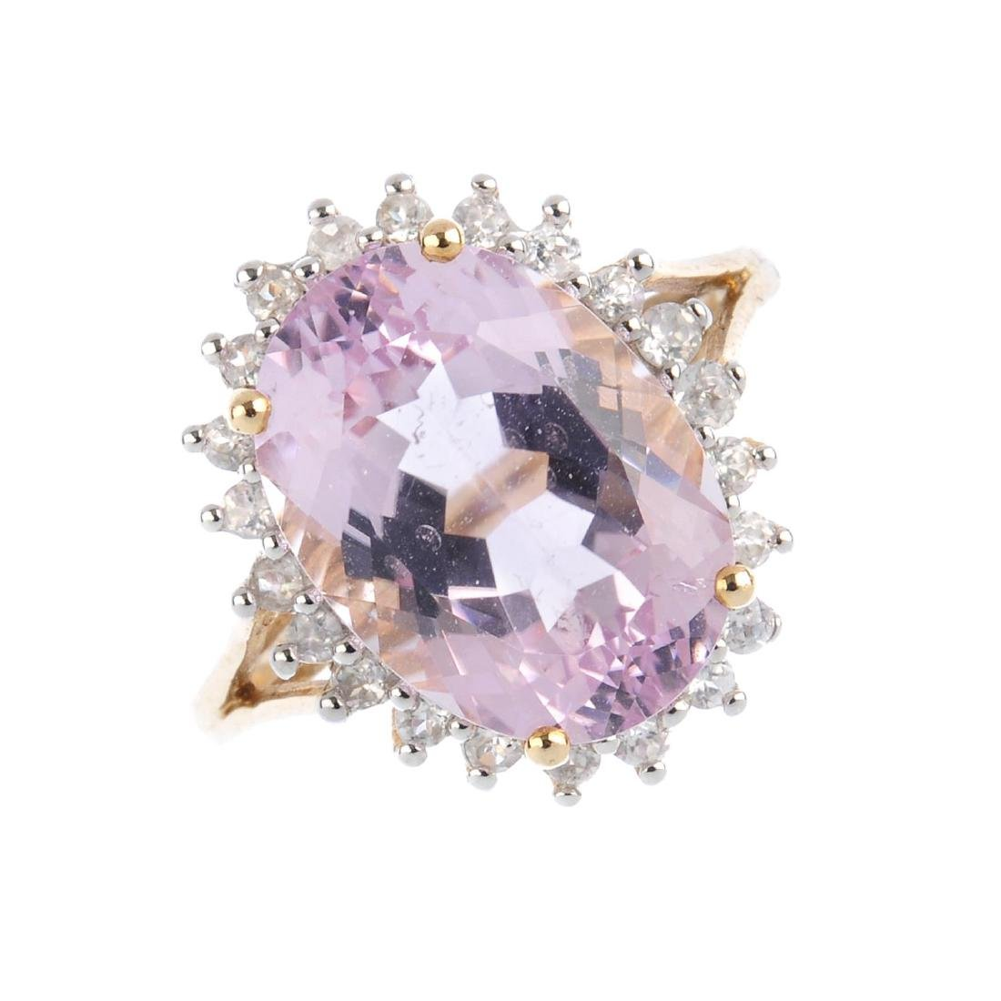 A 9ct gold kunzite and diamond ring. The oval-shape