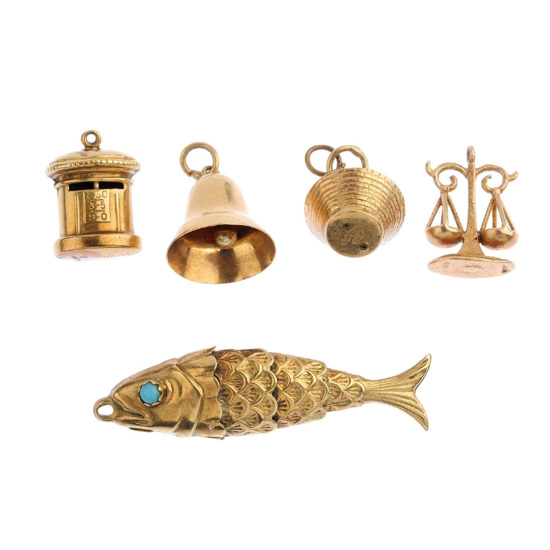 Seven charms. To include a 9ct gold fruit basket charm,