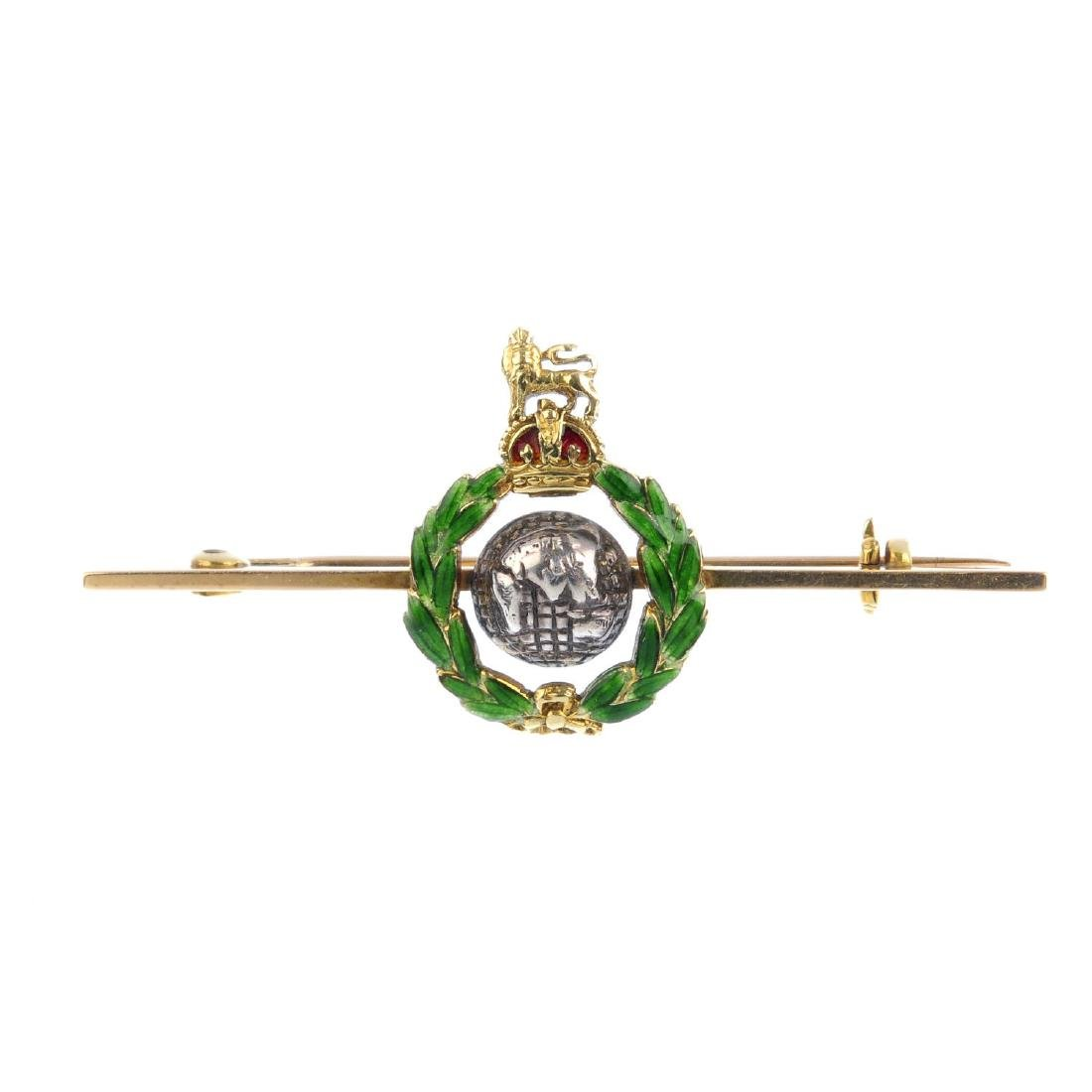 A bar brooch. Designed as a domed globe, within a green