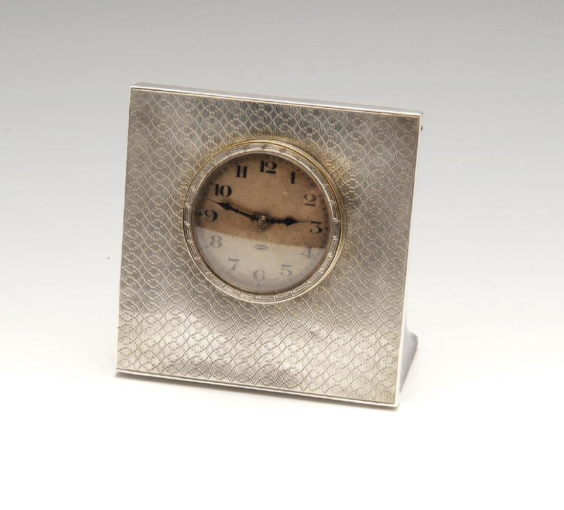 A 1920's silver mounted desk clock, of square shaped