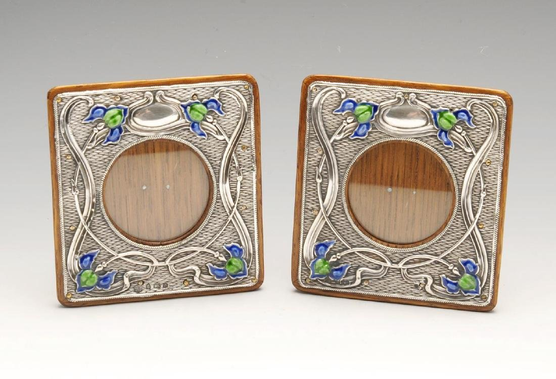 A matched pair of Art Nouveau silver mounted photograph