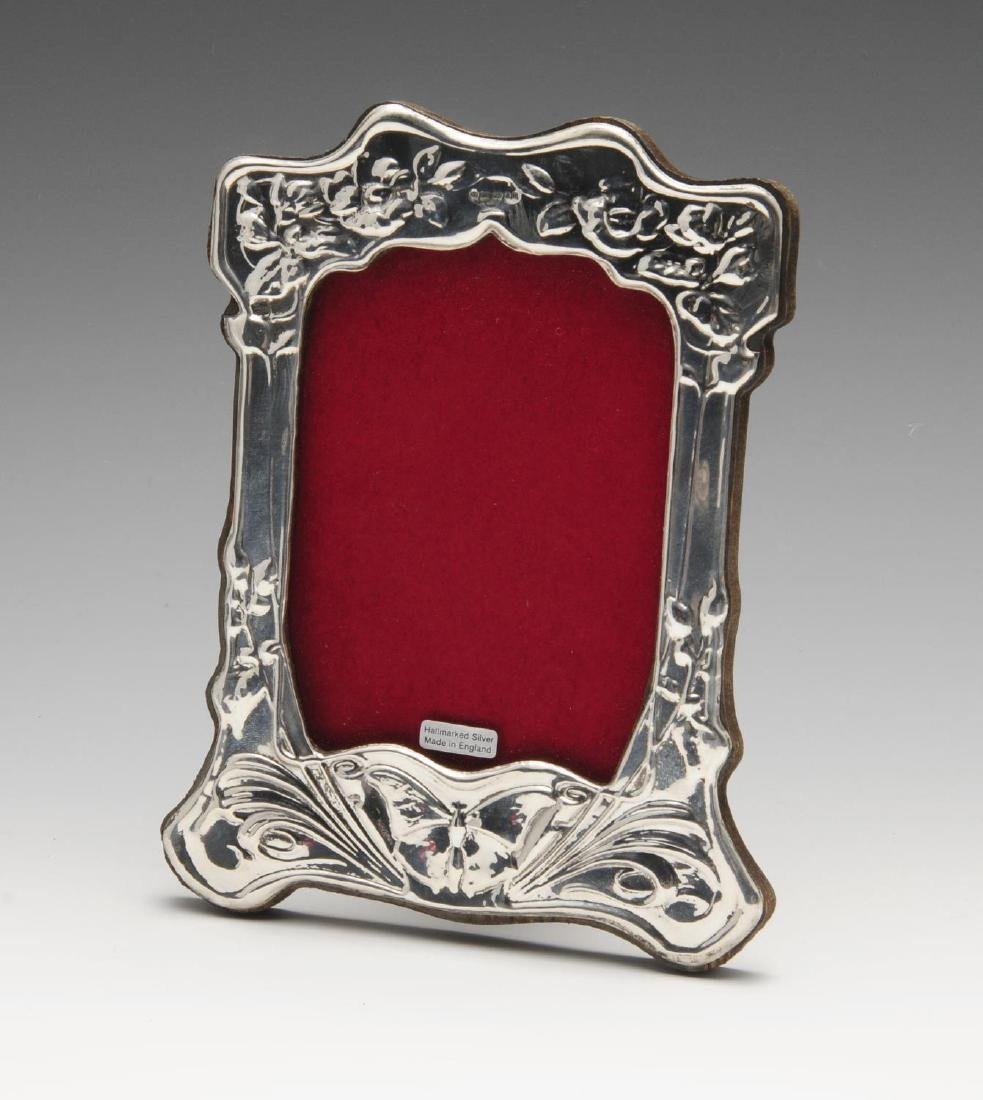 A modern silver mounted photograph frame, the shaped