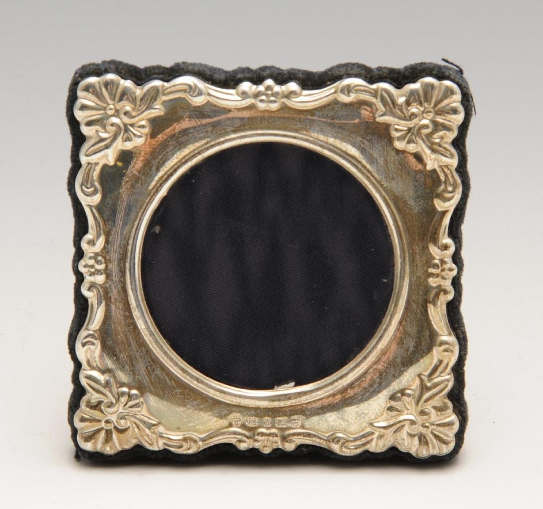 A modern silver mounted photograph frame, the shaped - 5
